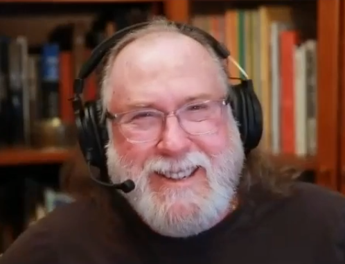 Chip Chapin, a kind-looking bespectacled older man with happy eyes and a nicely-kept beard smiles earnestly into the camera in front of a wall of wooden cabinets enclosing several orderly rows of books. A headset that includes a pair of headphones and a microphone sits atop Chip Chapin's balding head as he speaks about his investing experiences to his interviewer Jordan Thibodeau using an internet video-chat service.